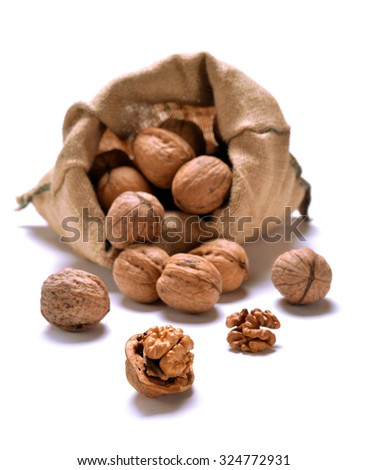 Walnuts and a bag on white - stock photo