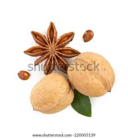 walnuts and anise star isolated on white background