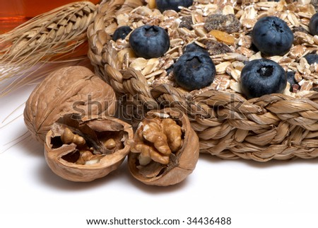 Walnuts And other dietary products on a light background - stock photo