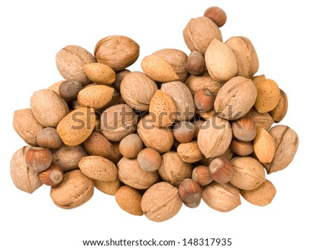 Walnuts, hazelnuts and almonds on white background