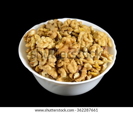 walnuts in a bowl on black background - stock photo