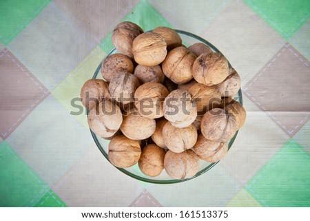 walnuts in a glass dish - stock photo