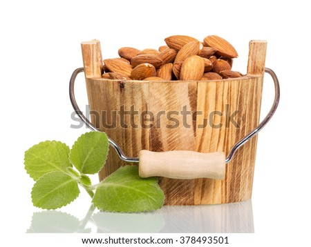 Walnuts in a wooden bucket isolated on white background - stock photo