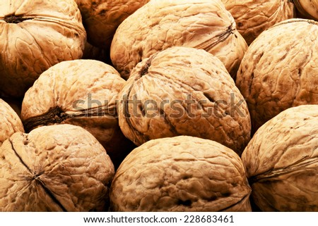 Walnuts in shells, one upon the other. Closeup - stock photo