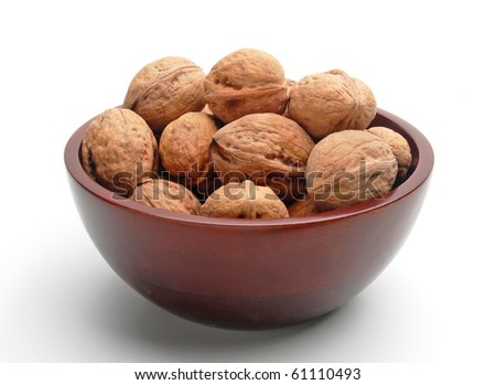 Walnuts in wooden bowl on white background - stock photo