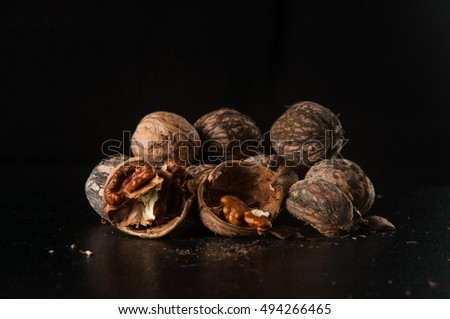 walnuts on a black background