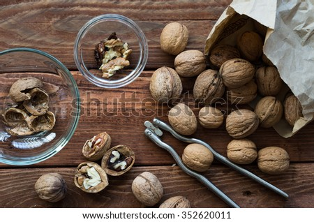Walnuts on the wooden table and the accessories