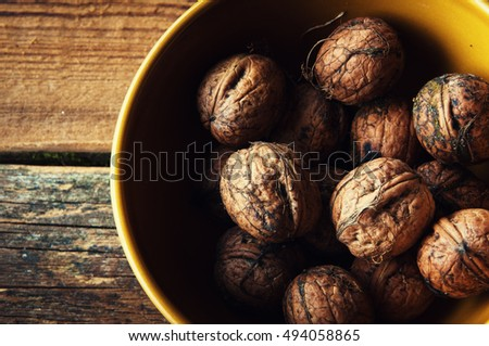 Walnuts on wooden background. Copyspace