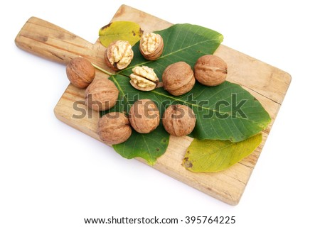 Walnuts on wooden board - isolated on white        - stock photo