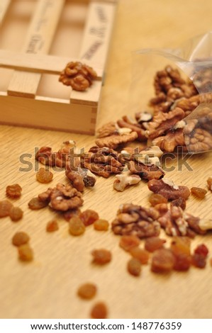 Walnuts scattered on the table - stock photo