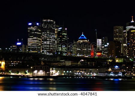 Walsh Bay and Sydney Skyline at Night - stock photo