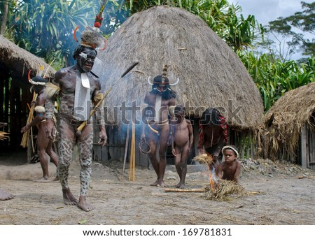 WAMENA, PAPUA, INDONESIA - November, 14: Papuan people in the traditional village on November, 14, 2008 near Wamena, Papua, Indonesia.