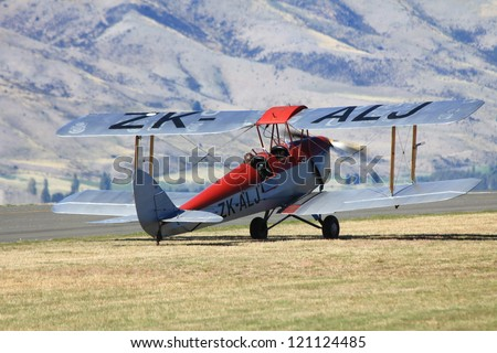 """WANAKA MARCH 03: Foker DR.1 vintage aircraft on the runway during the royal New Zealand air force 75th anniversary""""Warbirds Over Wanaka"""" airshow on March 03, 2012 in Wanaka New Zealand - stock photo"""