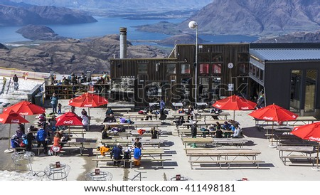 WANAKA, NEW ZEALAND - SEPT 22, 2015: Skiers enjoy spring ski conditions at  Cardrona skifield in New Zealand.  Cardrona is one of four ski fields near Queenstown in the South Island.   - stock photo