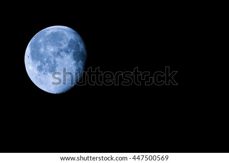 Waning gibbous moon, almost full moon, seen with an astronomical telescope with copy space (photo taken with my own telescope, no NASA images used) - stock photo