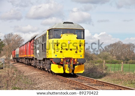 WANSFORD, ENGLAND - APRIL 3: A class 31 locomotive takes a demonstration TPO train to Peterborough for public viewing during the Nene Valley Railway spring diesel gala on April 3, 2011 at Wansford. - stock photo