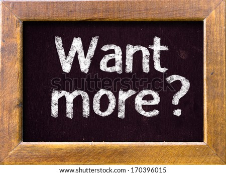 Want more ? handwritten on blackboard  - stock photo