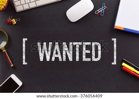 WANTED CONCEPT ON BLACKBOARD - stock photo