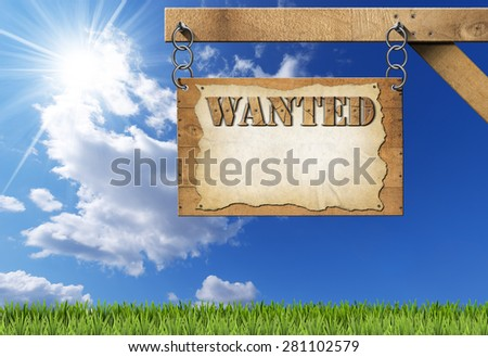 Wanted - Wooden Sign with Chain. Wooden sign with planks and torn empty parchment with text Wanted. Hanging from a metal chain on a wooden pole on blue sky with clouds and sun rays - stock photo