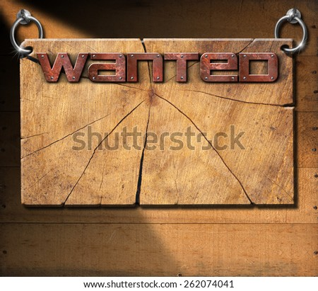 Wanted - Wooden Signboard on Wooden Wall. Wooden cracked sign with metallic text Wanted in the style of the wild west. Hanging on a wooden wall. - stock photo