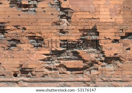 War Damaged Brick Wall as a Memorial - stock photo