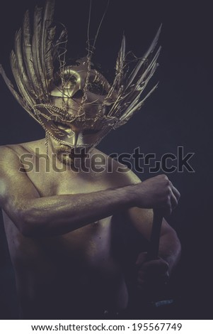 War, golden deity, man with wings and gold helmet