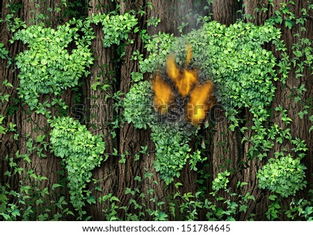 War in the Middle East concept as a forest of tall trees with a green vine shaped as the world map with the conflict zone burning with fire and smoke as a civil war revolution and political unrest. - stock photo