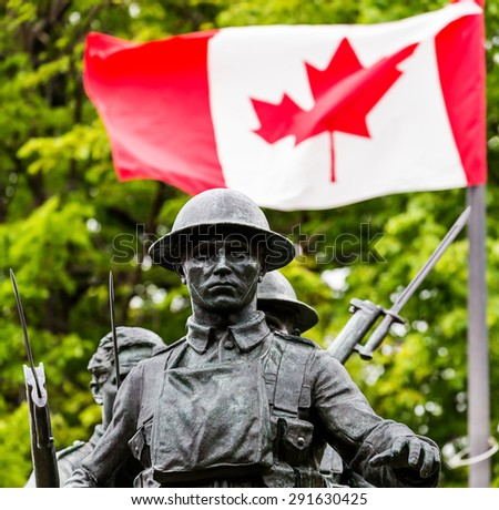 War memorial and Canadian flag in Charlottetown, Prince Edward Island, Canada. - stock photo