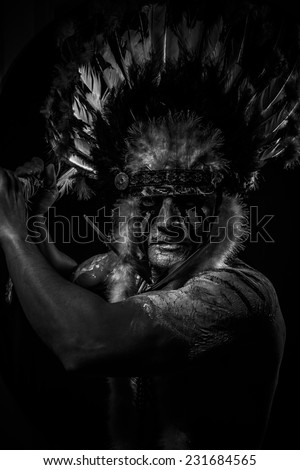 War Native, American Indian chief with big feather headdress - stock photo