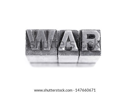 War sign,  antique metal letter-press type isolated