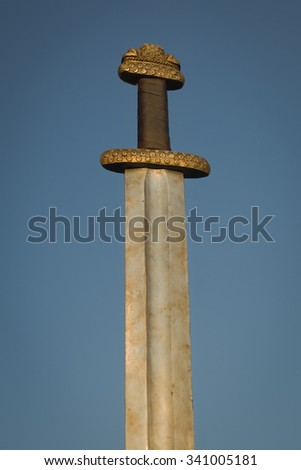 War symbol. Medieval viking sword against a blue sky - stock photo