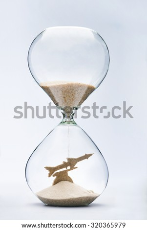 War time. Hourglass falling sand taking the shape of a launching missile - stock photo