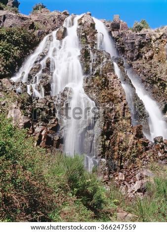 Waratah Falls is an amazing large waterfall that drops down into a gully below, Tasmania, Australia - stock photo
