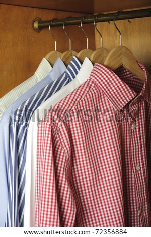 wardrobe and  shirts hanging - stock photo