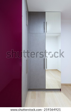 wardrobe furnishing in small room - stock photo