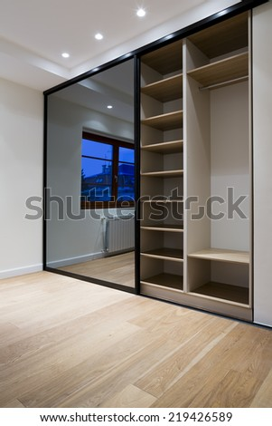 Wardrobe furniture in bedroom interior - stock photo