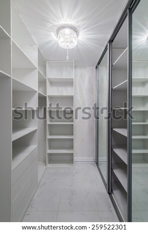 Wardrobe room interior in white with crystal luster - stock photo