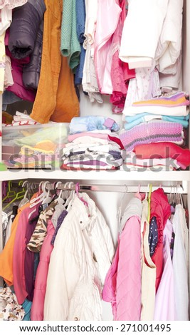 Wardrobe with child clothes - stock photo