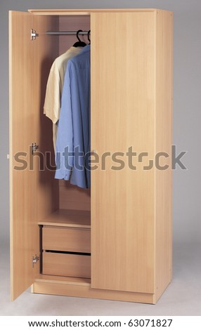 wardrobe with clothes on a plain background - stock photo
