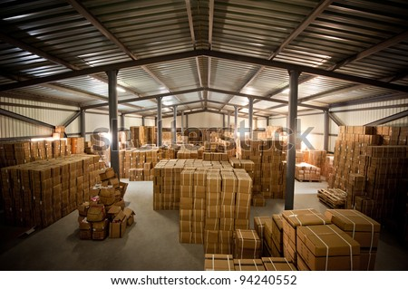 Warehouse and the box it - stock photo