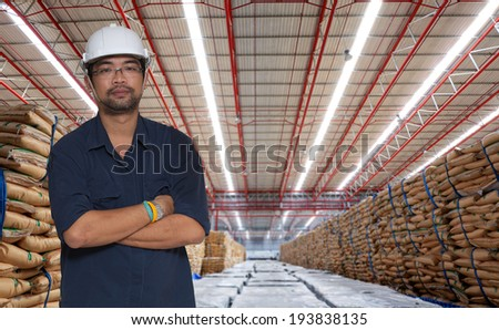 Warehouse and the sugar bag with asian worker - stock photo