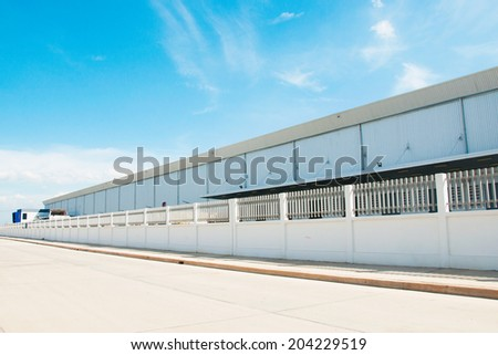 Warehouse building with beautiful blue sky - stock photo