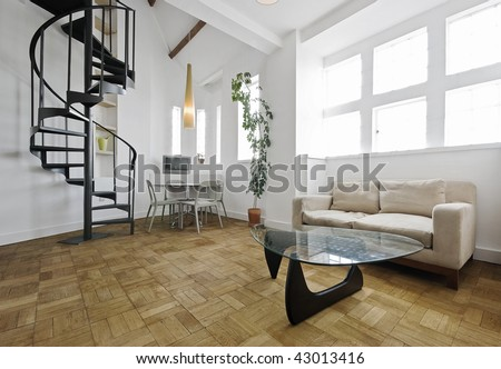 warehouse conversion apartment with metal spiral staircase - stock photo