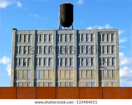 Warehouse converted for storage with water tank and deep blue sky in DUMBO, Brooklyn - stock photo