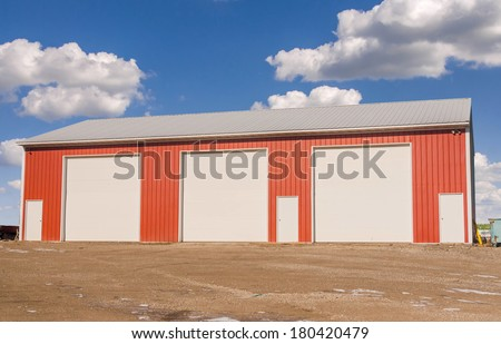 Warehouse for industrial unit or agriculture storage. Steel building. - stock photo