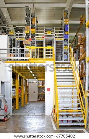 Warehouse interior with safety cage rooms - stock photo