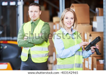 Warehouse Management System. Worker with barcode scanner