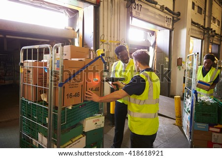 Warehouse manager overseeing the preparation of a delivery - stock photo