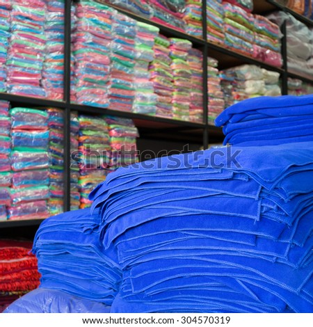 warehouse of towel softness fluffy fiber fabric of textile industrial for sale - stock photo