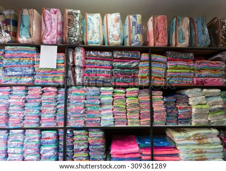 warehouse of towel softness fluffy fiber fabric on shelf for sale, industrial of textile - stock photo